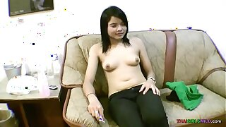 Baby face Japanese nubile opens up shaved muff for foreign dick