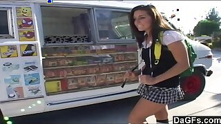 Ice cream man dips his popsicle just about a young teen